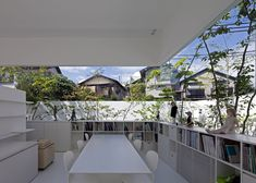 Floating fence wraps house and doll-making studio by UID Architects - que miedo las muñecas