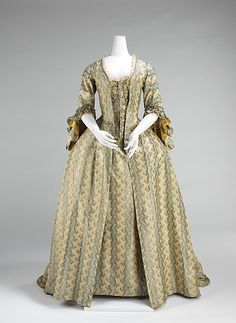 "Robe à la Française, 1760-70, French, silk.    ""Women with coquettish airs were imposing in robes à la française and robes à l'anglaise throughout the period between 1720 and 1780. The robe à la française was derived from the loose negligee sacque dress of the earlier part of the century, which was pleated from the shoulders at the front at the back..."""