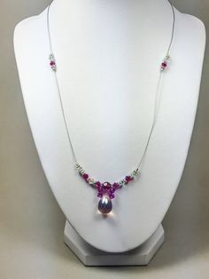 Pretty delicate necklace, pink Swarovski crystal, silver connectors and a pink Czech bead made this beautiful necklace a piece you will love to have. Measure: 20 inches