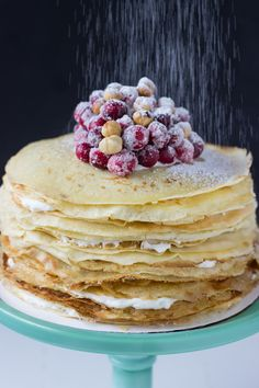 A stunning and simple cranberry hazelnut crepe cake.