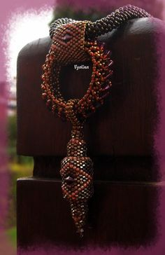 "Pendentif ""Nagar""  * love the wide beaded bail with the diamond shape AND the wide beaded donut"