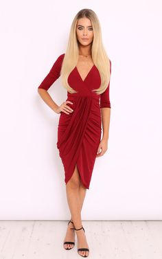 Stun this season in this chic feminine 3/4 sleeve midi dress in a gorgeous deep red colour. The plunging V neckline, front split running up the left leg in a soft touch slinky material makes this dress the perfect addtion to your AW15 wardrobe. Style this up with strappy heels and a matching clutch for a hot evening look.