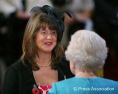 My dearest friend Marie receiving her MBE from Her Majesty Queen Elizabeth II. So proud of you Marie Erwood!