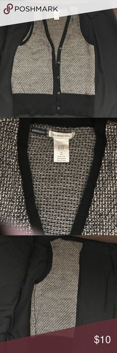 Gap black and white sweater button up vest Gap black and white button up sweater vest. Never worn and only tried on. But took off tags. Size medium fits a small or xsmall GAP Other