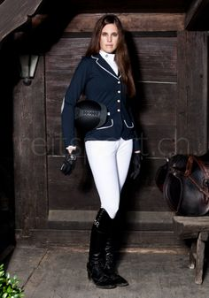 This lovely lady is wearing a Spooks show jacket navy, along with a body shirt from Cavallaria Toscana, white Equiline trousers grip, with a Pikeur helm. http://www.reitsport.ch/reiter/reithosen/kniebesatz/equiline-reithose-kniebesatz-cedar/ash-x-grip-ash-damen-weiss http://www.reitsport.ch/reiter/turnierbekleidung/turniersakkos/spooks-turnierjacke-showjacket-navy http://www.reitsport.ch/reiter/oberbekleidung/langarm/cavalleria-toscana-turniershirt-body-damen-weiss