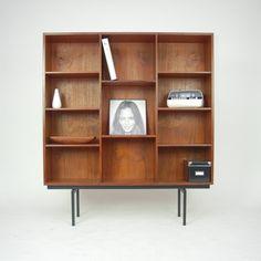 Anonymous; Teak and Enameled Metal Bookcase by Lovig, c1960.