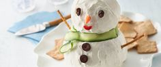 All holiday appetizers should be this fun!  This adorable snowman is made of a delicious spread of seasoned cream and Cheddar cheeses.