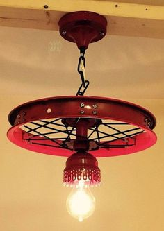 We created this bike rim chandelier from the wheel of a vintage bike. diameter) It also includes various vintage light fixtures and lamp Garage Furniture, Car Part Furniture, Automotive Furniture, Automotive Decor, Lustre Industrial, Industrial Chandelier, Diy Chandelier, Rustic Lighting, Vintage Lighting