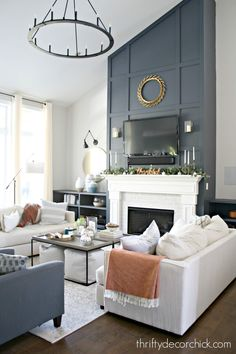 How to give a tall fireplace wall a ton of character and drama with molding and paint. - Dark blue tall fireplace wall with molding in living room decor High Ceiling Living Room, Farm House Living Room, Accent Walls In Living Room, Living Room Design Layout, Living Room With Fireplace, Tall Fireplace, Living Room Grey, Long Living Room, Fireplace Wall