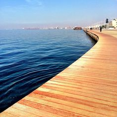 """<3 at first sight: the """"New Coast"""" of Thessaloniki, a unified and interesting promenade path next to the open sea horizon, the feeling of the infinity due to the intense presence of water, the line of the horizon inside the sea, the """"walker"""" exposed to the light, to the open perspective, the differentiation, the interchange, the possibility of visual isolation, the shading, the surprise. My Town, Differentiation, One And Only, Daydream, Paths, Perspective, Infinity, Greece, Coast"""
