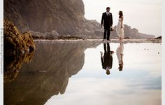 Newlyweds stand on Pfeiffer Beach in Big Sur. via #ianmartin wedding photojournalism I Love!