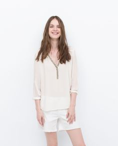 Image 1 of SHIRT WITH NECKLINE DETAIL from Zara
