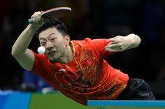 Ma Long, of China, returns a shot to Zhang Jike, of China, during the men's…