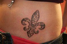 Fleur-de-lis lace tattoo