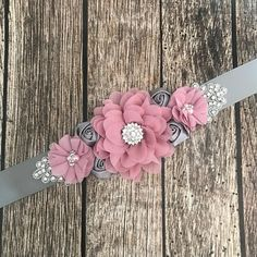 This beautiful dusty pink and grey maternity sash will be the finishing touch for any mommy to be! Pink and grey flowers are clustered together and finished with a rhinestone button.