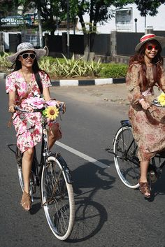 Indonesian girl with their old bike