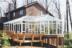 Custom conservatory with redwood pier supports leads to deck