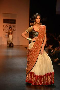 SHYAMAL & BHUMIKA US: this beautiful lehenga choli is made in the traditional Gujarati wedding colors white and red!