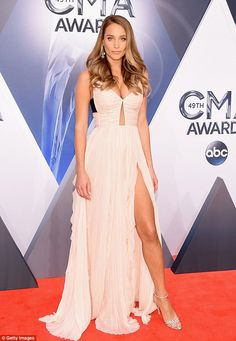 She's got leg... and a lot more: Hannah Davis looked stunning in pale pink at the CMAs on ...