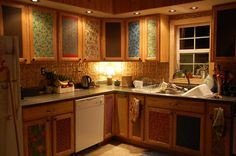 Use fabric and Mod Podge to deal with cabinets that you don't like!