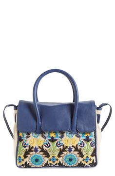 This convertible satchel from Sam Edelman gives off such a chic, vintage vibe. Elaborate beading and embroidery add stunning details to make it even more unique.