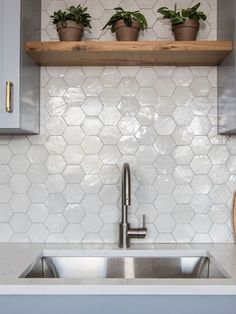 clé weathered white hexagon zellige tiles shining in the backsplash of this kitchen. we offer glazed zellige tiles in various colors. come find your true color. Modern Kitchen Tiles, Kitchen Wall Tiles, Backsplash Ideas For Kitchen, Kitchen Sink, Backsplash Kitchen White Cabinets, Kitchen Ideas, Big Kitchen, Stylish Kitchen, Kitchen Trends