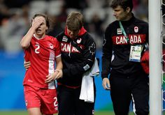 Canada's Allysha Chapman leaves the pitch after being injured during a quarter-final match of the women's Olympic football tournament between Canada and France in Sao Paulo, Brazil, Friday Aug. 12, 2016. Chapman, clutching a furry animal with the one arm that wasn't in a sling after the game, paid the price for her commitment to the Canadian soccer women's team. THE CANADIAN PRESS/AP/Nelson Antoine
