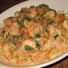 Creamy Shrimp Sauce With Spinach, Mushrooms, And Tomatoes Over Spaghetti Is The Tasty Result Of A Friendly Challenge To Cook Keri From Her Pals On The Recipe Exchange.