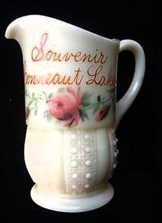 Custard glass souvenir pitcher with beaded base.