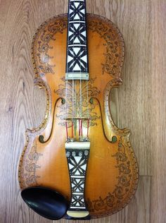 Norwegian hardanger fiddle :) I would love to have one of these. Used by my great uncle in concerts