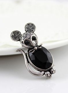 The almost tribal - like markings on this cute mouse brooch are what attract me to this piece.