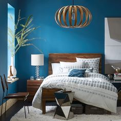 Like idea of having a bolder brighter color in the back bedrooms.  Wood bedframe and wooden light fixture seem to echo elements of main floor.