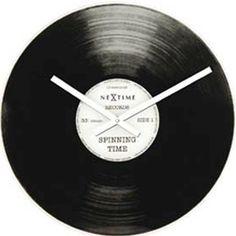 Es un vinilo? es un reloj? es... Reloj de pared Spinning Time