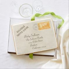 """This jumbo shortbread cookie gives the impression of a vintage envelope with stamp addressed to the new baby. Personalize for the baby and your own detail in the address placeholders and the 'Handle with love' text. The stamp celebrates California's centennial of statehood in 1950, with a San Francisco postmark dated 1951. These are not real, but they are edible. The jumbo cookie measures 11.25"""" x 8.75""""; Weight: 18 oz, and is boxed with a decorative ribbon."""