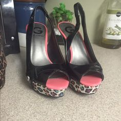 By Guess heels Worn once. Leopard colored by guess heels. Super comfy. Guess Shoes Heels