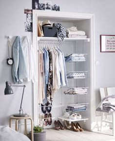 Turn an alcove into a storage area with a clothes rail, shelf and some baskets hung together with rope.