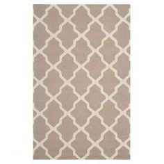Hand-tufted wool rug in beige and ivory with a trellis motif. Made in India.  Product: RugConstruction Material: 100% WoolColor: Beige and ivoryFeatures: Hand-tufted in India Note: Please be aware that actual colors may vary from those shown on your screen. Accent rugs may also not show the entire pattern that the corresponding area rugs have.Cleaning and Care: Blot spills immediately. Professional cleaning recommended.