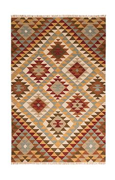Four sizes available plus matching cushion covers! The fair trade Kazak wool/ cotton kilim rug is hand loomed on a fair trade basis and features an attractive geometric design.