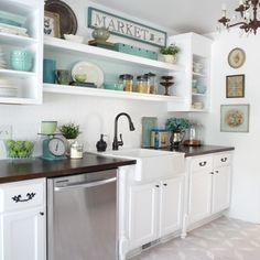 I really like the white cabinets and dark stained counters...and the blue dishware sets everything off.  Definitely a combo I want to see in my forever house!