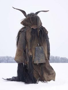 This image is based on Bulgarian Kukeri and Mummers, the traditions of pre-religious and pre-pagan shamanism.  Image by Smultronstället: Wilder Mann, by Charles Fréger.