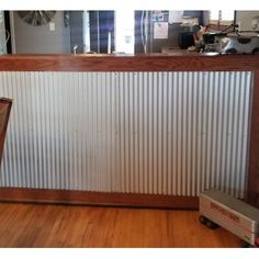 Dakota Tin Corrugated metal wainscoting is found in more and more homes and commercial spaces to help break up a contrasting accent wall; add a rustic, industrial contrast to a cleanroom; or add a unique look to bars and countertop - there are so many uses for these metal wall panels. Create a mountain retreat, ranch, or southwestern-style look in your home or commercial space by applying corrugate to indoor and outdoor spaces, walls, ceilings, or other home decor and furniture. About… Vinyl Wall Panels, Metal Wall Panel, Wood Panel Walls, Metal Panels, Wood Wall, Wainscoting Wall Paneling, Wainscoting Styles, Metal Ceiling Tiles, Ceiling Grid