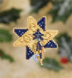 "MH187305 - Shining Star (2007) - Mill Hill - Seasonal Ornament / Pin Kits - Winter Holiday Kit Includes: Beads, treasures, perforated paper, pin back, floss, needles, chart and instructions. (1 of 6 designs in display Size: 2.5"" x 2.5"""