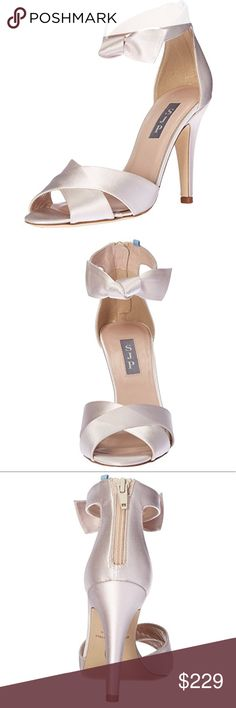 New SJP by Sarah Jessica Parker Buckingham heels Brand new Command attention with the SJP by Sarah Jessica Parker™ Buckingham. Satin or metallic leather upper. Front bow and back zipper closure. Open-toe silhouette. Leather lining and footbed. Wrapped cone heel. Smooth leather sole. Made in Italy. Brand new without box it comes with dust bag  Product measurements were taken using size 37.5, width B - Medium. Please note that measurements may vary by size. Weight of footwear is based on a…