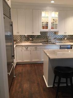 White kitchen backslash 2016. Antique mirror subway tiles. Unique but classic style.