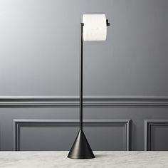 Shop free standing black toilet paper holder. Modern, matte black aluminum fixture freestands a single roll.