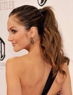 We're fans of both sleek and rough textured ponytails, but what we love even more is when the two are combined. Minka Kelly's ponytail is slicked back at the crown and left rough and wavy through the lengths. The effect is dressed up, yet romantic.
