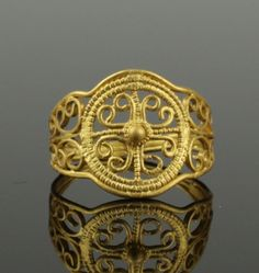 STUNNING ANCIENT ROMAN GOLD RINGRoman, Imperial Period, ca. 2nd century CE. An amazing 22KT+ gold ring in granulated style with an openwork decoration that exte