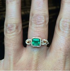 The seriously beautiful emerald Knotty ring.   18k yellow gold  with .72ct emerald center and .48ct diamond pavé.  info@norakogan.com for more information! #emerald #emeraldring #shibari #diamondpavé