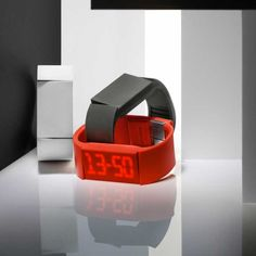 """MUTE WATCH:  A revolution in time! Tap, touch, pinch and swipe to access the clock, alarm or timer. A built-in motion sensor processes fingertip movements to adjust functions—including strength of vibrations. Whether wearer is asleep or behind a podium, the Mutewatch will pulsate when it's time for the next step. Tap on the top of the digit to increase a number, or the bottom to lower. When it's time to erase, simply """"pinch"""" the touch screen."""