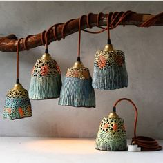 Ceramic pendant lights and pottery handmade by Madeline King on the Sunshine Coast Australia. Small batches of handmade ceramic lamp shades, ceramic lamps, pottery pendant lights, ceramic plant pots, ceramic bells and ceramic decor.